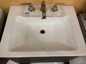 From the top down. The sink top is quickly available with a single hole for a single hole faucet. The three hole version requires a longer lead time.