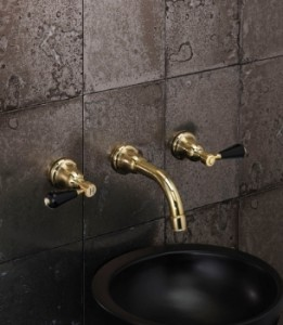 Fairfield in unlacquered brass with Black Crystal, NOT porcelain, levers.