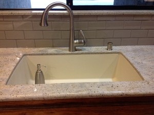 After: Composite Sink, Stainless Steel Faucet and gleaming glass tile