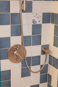 The shower valve (Made in USA) is thermostatic which allows for perfect control of flow and temperature. The top handle is for the shower and the bottom handle is for the tub spout