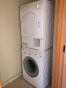 Interior Laundry Room featuring stackable washer/dryer
