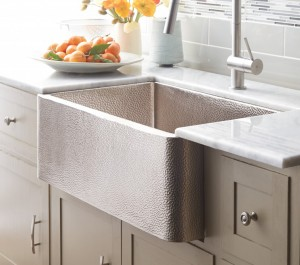 Apron Front Sinks can be porcelain, stone, stainless steel, copper or nickel as shown here